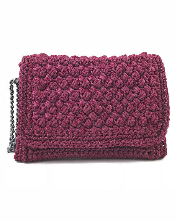 Burgundy crochet shoulder bag With a classic, timeless design.